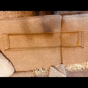 Gold floating shelf. Never used.